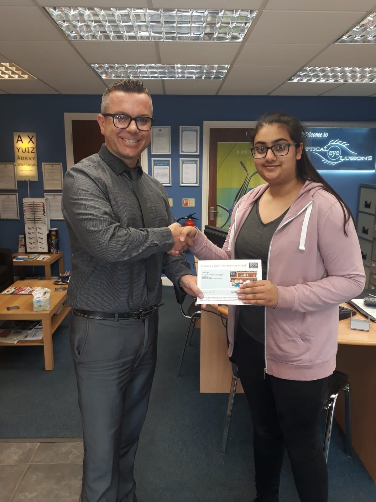 Deepika collected her book voucher from Optical Eye Lusions in Hall Green, Birmingham