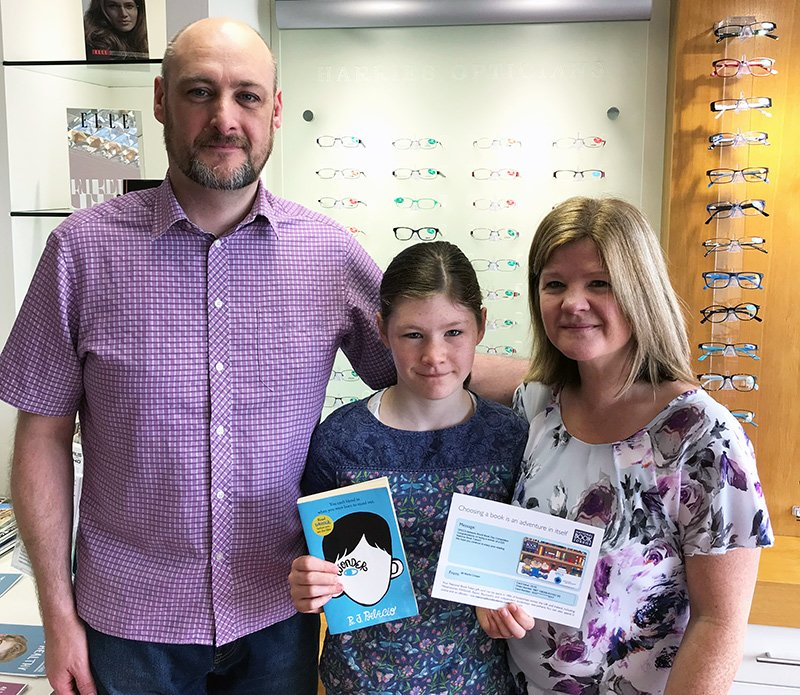 Erin collected her voucher from Harries Opticians in Stockport