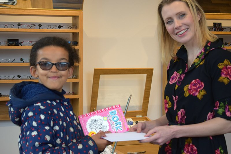 Maya collected her voucher from school governor Sarah Edwards at Eyes on the Common in Ealing