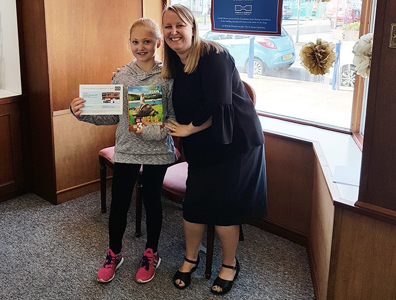 Olivia collected her book voucher from The St Annes Opticians in Lytham St Annes