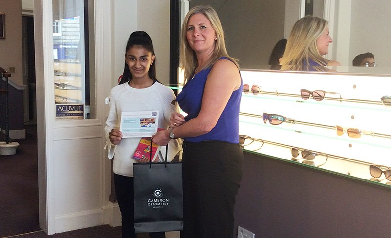 Salilah collected her book voucher from Cameron Optometry in Edinburgh