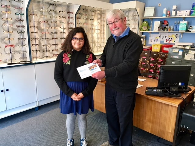 Amber collected her book voucher from P.B. Conway Opticians in Abingdon
