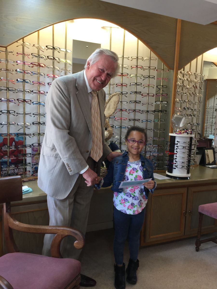 Daisy collected her book vouchers from Rex Wingate & Partners Eye Care Centres, Southampton