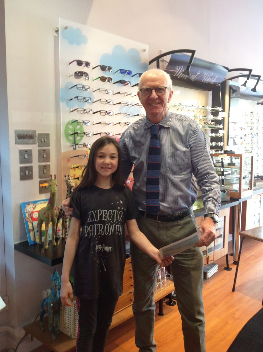 Frankie collected her book vouchers from Harris Rundle Opticians Ltd, Belfast