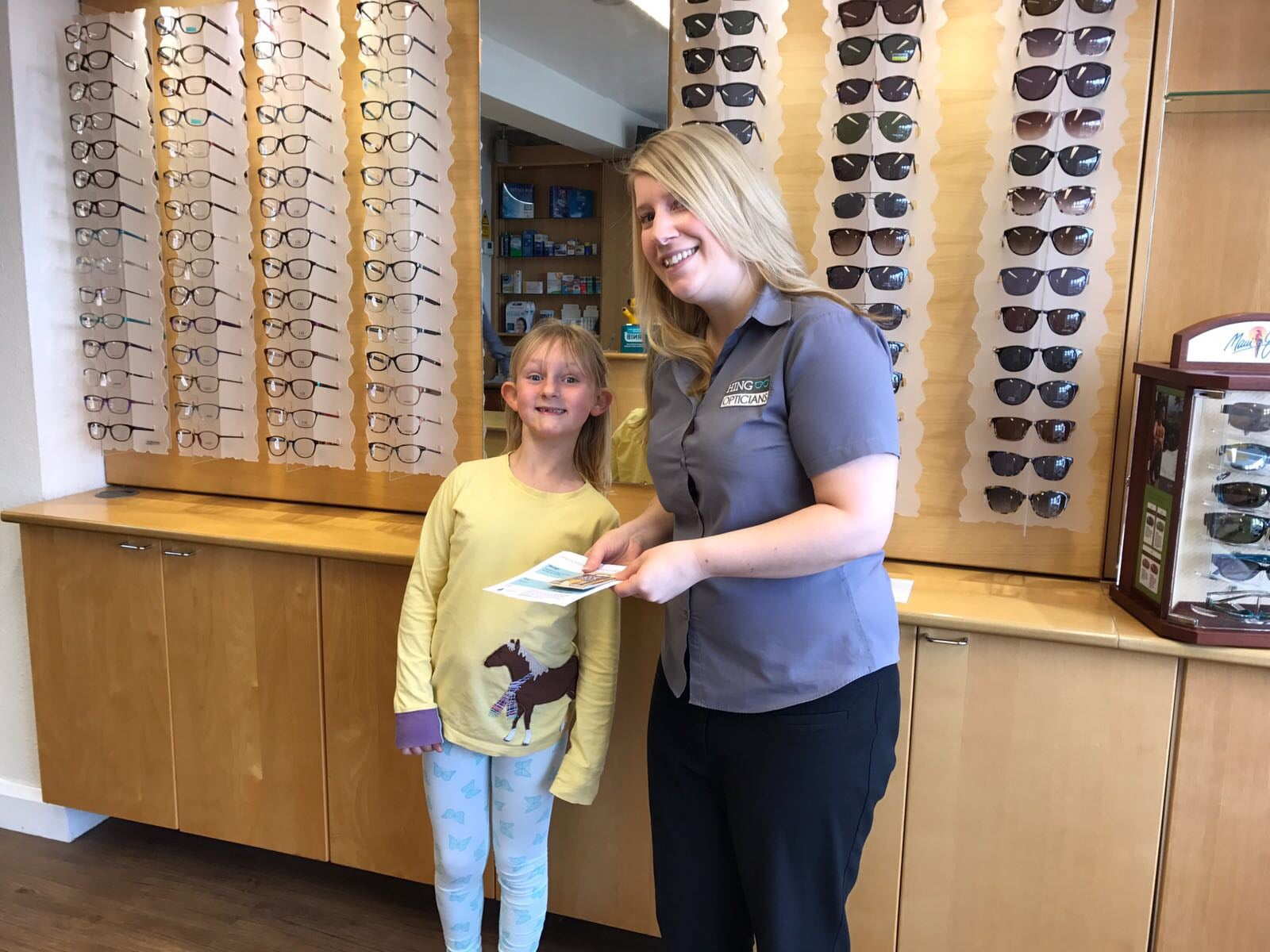 Megan collected her book vouchers from Stephen Hing Opticians, Shefford