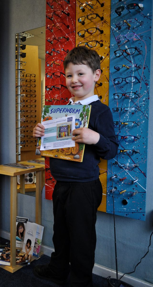 Ollie collected his book vouchers from Bellamy Eyecare, Irthlingborough