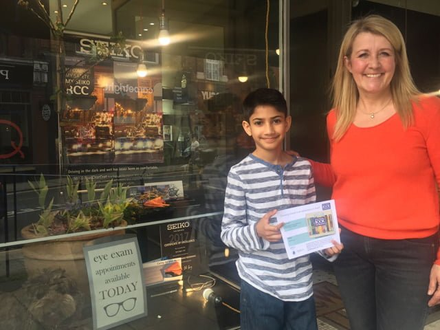 Anush collected his book vouchers from Spectique Ltd, Reigate