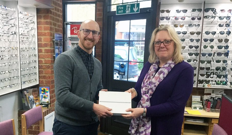 Nadia Stanbridge collected her iPad from James Salter at A R Salter Opticians in High Wycombe