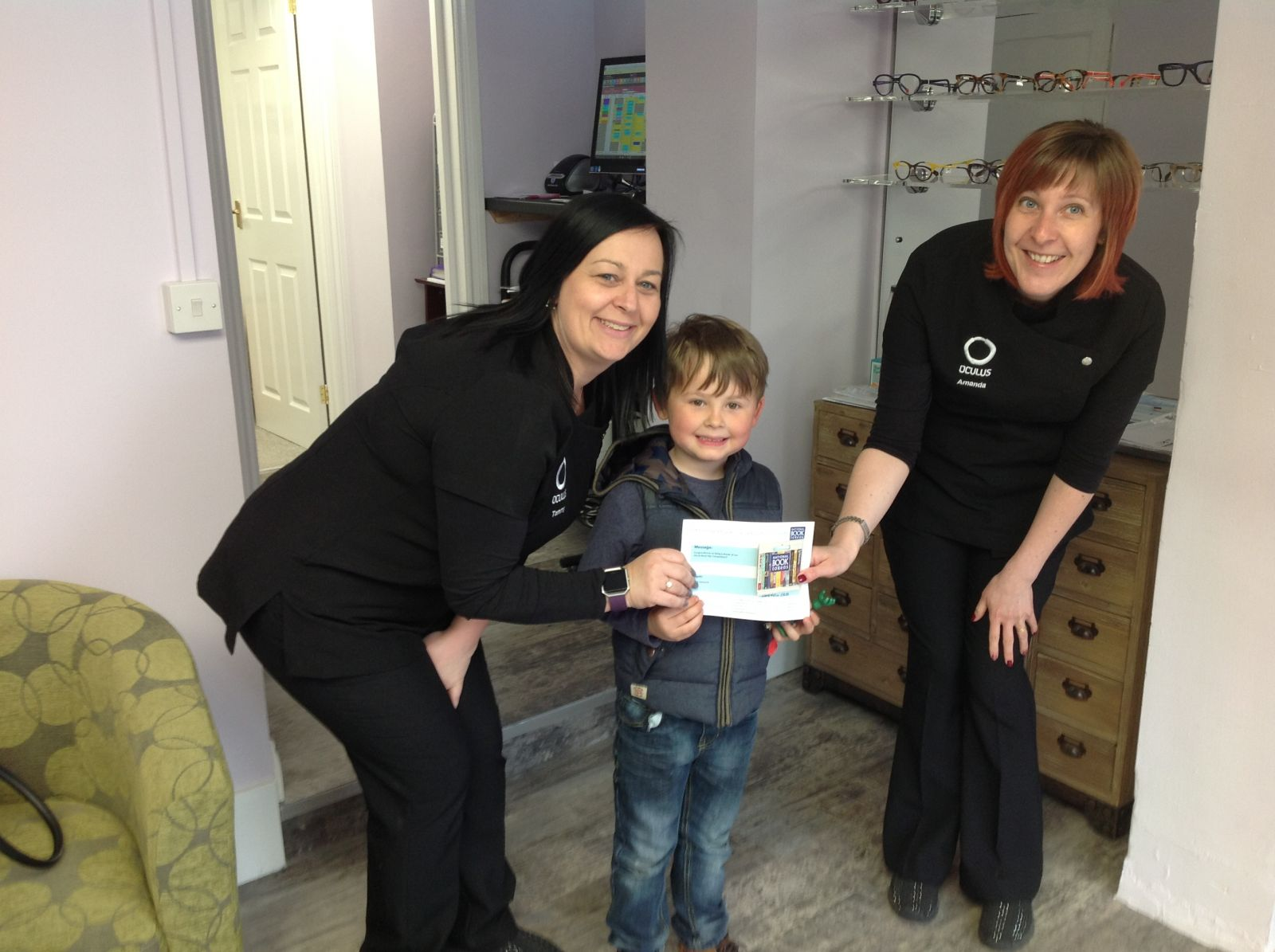 Zachary collected his book vouchers from Oculus Contact Lens Centre, Norwich