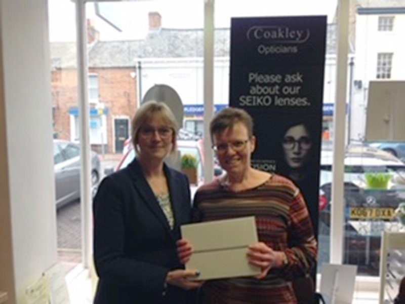 Karen Franklin collecting her iPad from Danielle at Coakley Opticians in Long Sutton