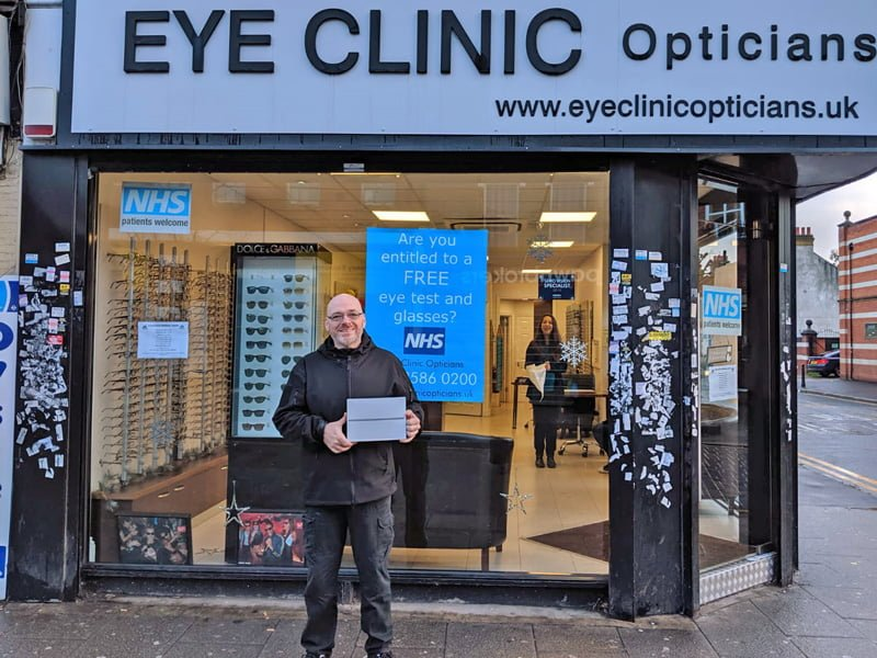 Darren McEvilly  collecting his iPad from Eye Clinic Opticians in East Ham