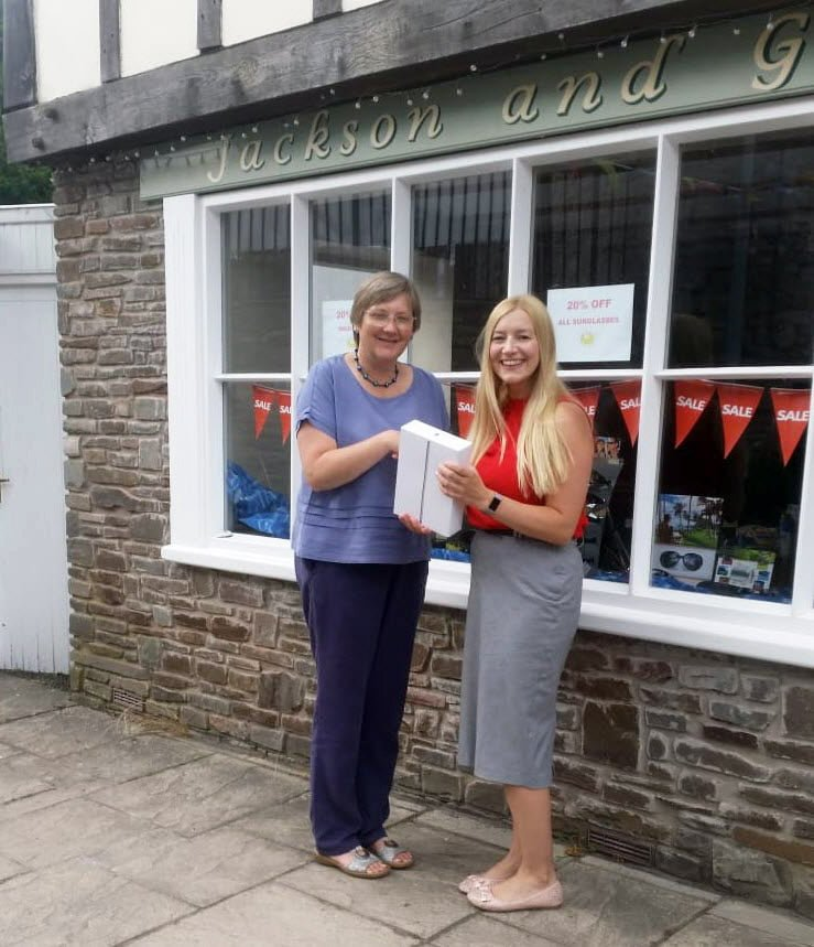 Gemma Lewis collecting her iPad from Jackson & Gill Opticians in Hay-on-Wye